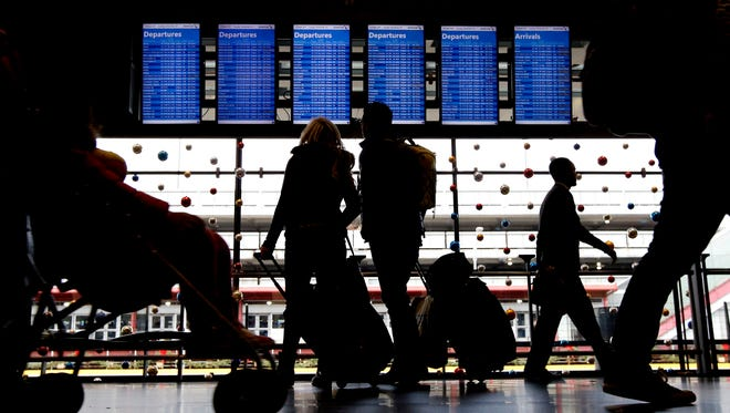 Travelers walk to their gates at Chicago's O'Hare International Airport on during the Thanksgiving weekend (Nov. 29, 2015).
