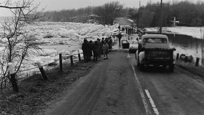 Massive chunks of ice overtake Gordon's Bridge north of Sartell during April 1965.