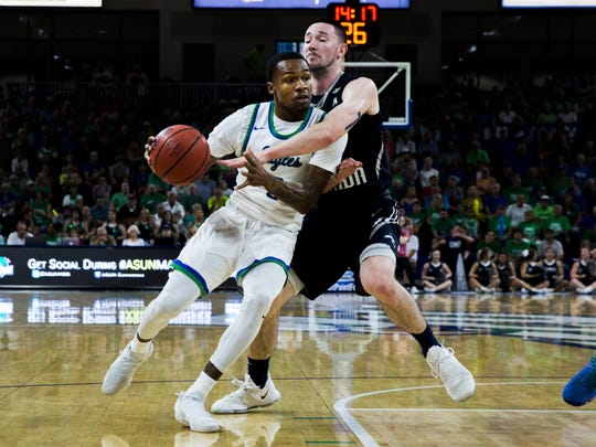Florida Gulf Coast University guard Brandon Goodwin, #0, dribbles the ball against the North Florida defense during their ASUN tournament semifinal game at Alico  Arena on Thursday, March 1, 2018.