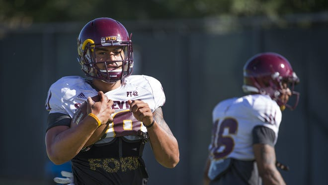 Arizona State linebacker Laiu Moeakiola runs with the ball during practice in Tempe, Wednesday, Sept. 14, 2016.