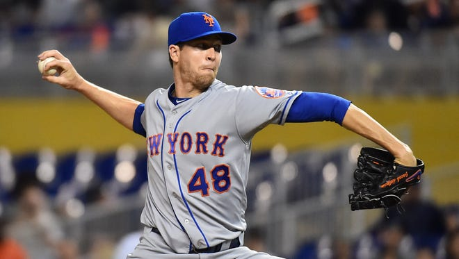 New York Mets starting pitcher Jacob deGrom (48) delivers a pitch in the first inning against the Miami Marlins at Marlins Park.