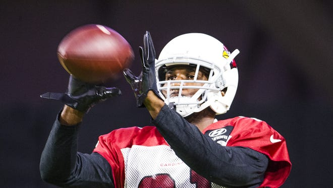 The Arizona Cardinals continue camp at University of Phoenix Stadium in Glendale, Monday, July 30, 2018.  Cornerback Patrick Peterson catches a ball during drills.
