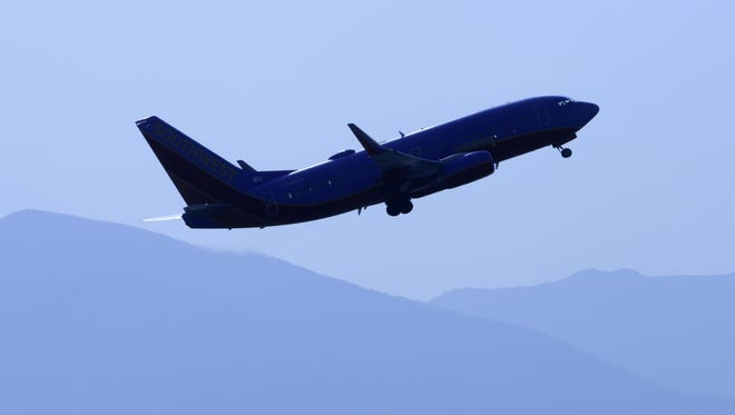 A jet takes off from Salt Lake City International Airport on July 18, 2014.