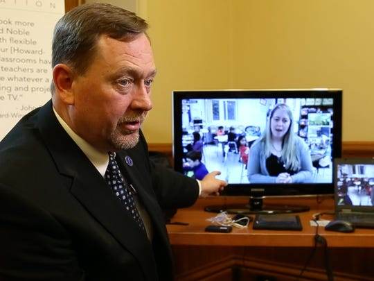 John Carver, superintendent of the Howard-Winneshiek school district demonstrates for legislators the high-speed capabilities of virtual classroom learning April 9 at the Iowa Statehouse in Des Moines.
