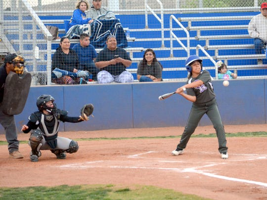 Diamonique Castillo of the Rockies swings at the plate in Thursday's Majors division game against the Pirates at Bob Forrest Youth Sports Complex.