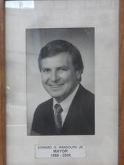 "This is the photo of Edward G. ""Ned"" Randolph Jr. on the ""wall of mayors"" in Alexandria City Hall. Randolph, who served five terms as mayor, died Tuesday. Based on information at City Hall, it appears Randolph was the longest-serving mayor in Alexandria's history."