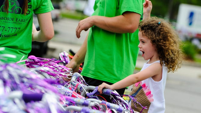 Laborde Earles Law Firm host event to give away bikes and helmets to deserving children in the Lafayette, Alexandria and Marksville communities.
