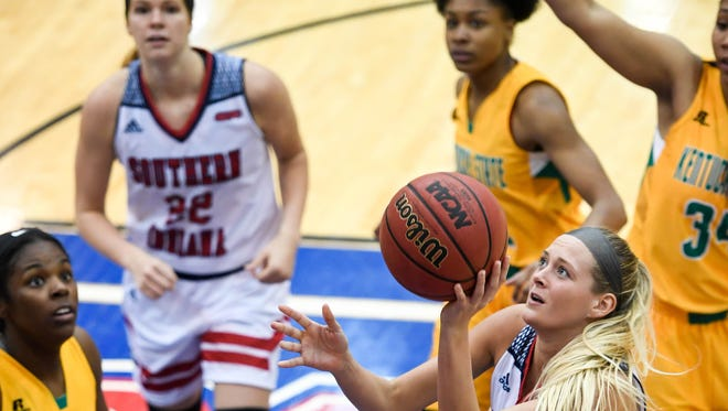 University of Southern Indiana's Kaydie Grooms takes a shot in the third quarter as the USI women play the Kentucky State Thorobreds at the PAC arena Wednesday, December 7, 2016.