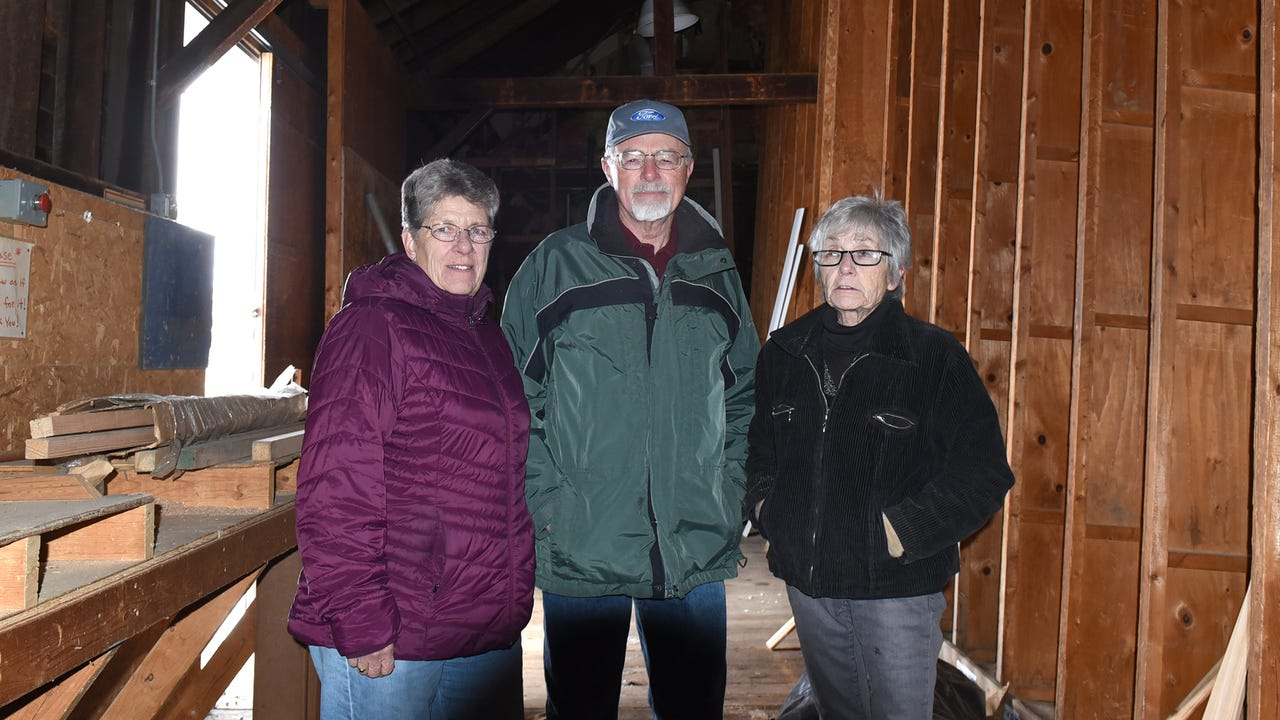 Jane and Ralph Emmon and Linda Dagenhardt talk about the importance of trying to save the Milford railroad depot.