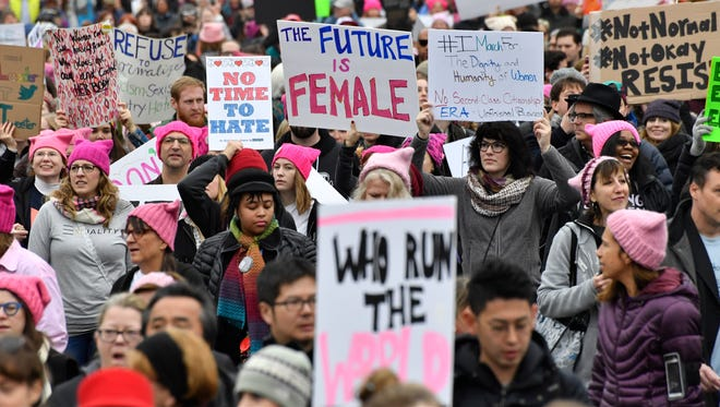 People walk to the rallying point for the start of the Women's March on Washington in Washington, D. C. on Jan. 21, 2017.