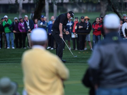 Phil Mickelson pumps his fist after sinking his tee shot from the rough on 16 at the La Quinta Country Club during the 1st round of the CareerBuilder Challenge on Thursday, January 19, 2017.  He finished the day tied for 2nd.