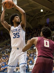 Duke's Marvin Bagley III (35) looks to score as Florida State's Phil Cofer (0) defends during the first half of an NCAA college basketball game in Durham, N.C., Saturday, Dec. 30, 2017. (AP Photo/Ben McKeown)