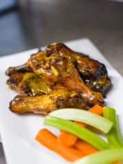 Smoked wings with gold sauce at Mill River Brewing