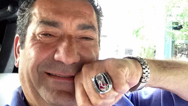 Yankees fan Luigi Militello displays the 2013 Red Sox World Series ring he found at his New York restaurant.