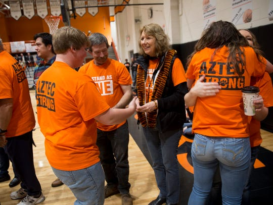 Aztec High School students honor their faculty and staff members during an assembly on Friday at Lily White Gym at Aztec High School.