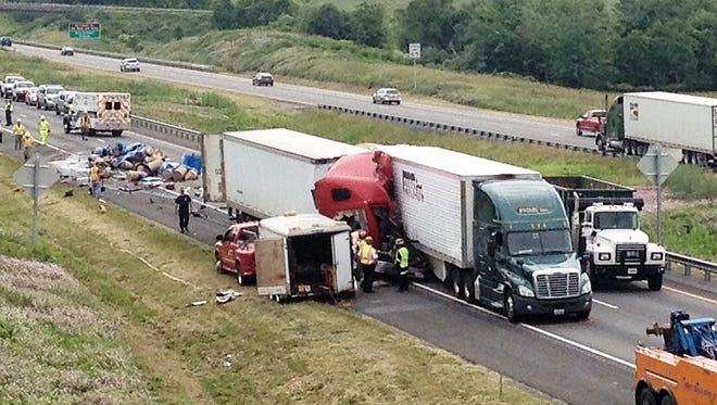 State police and emergency crews work a scene on Interstate 81 south of Staunton on Wednesday, June 11, 2014, where two tractor-trailers wrecked and one driver died.
