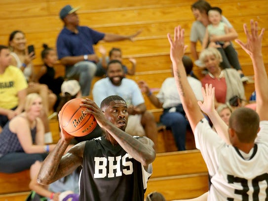 Bremerton's Marvin Williams (left) looks for an open