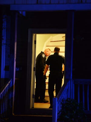 A sheriff's deputy with the Plymouth County Bureau of Criminal Investigation, left, responded to photograph the scene and document evidence as Brockton police investigated a reported home invasion at a home on West Chestnut Street in Brockton, Wednesday, Sept. 9, 2020. A man who was shot was taken by ambulance to Good Samaritan Medical Center in Brockton.