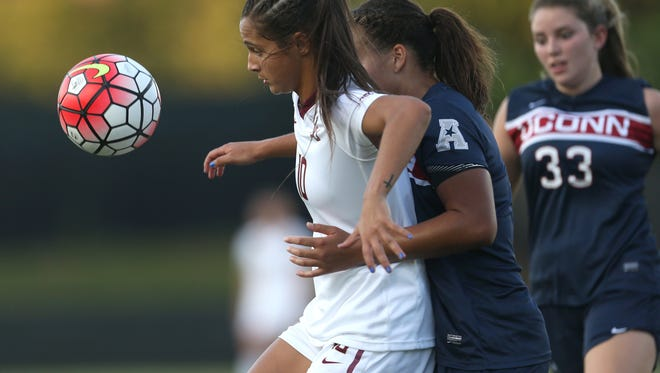 FSU's Deyna Castellanos holds UConn's Toriana Patterson off the ball during their game at the Seminole Soccer Complex Thursday.