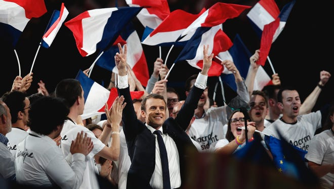 French President Emmanuel Macron, from the centrist En Marche! (Onward!) political party, acknowledges the crowd at rally in Paris.