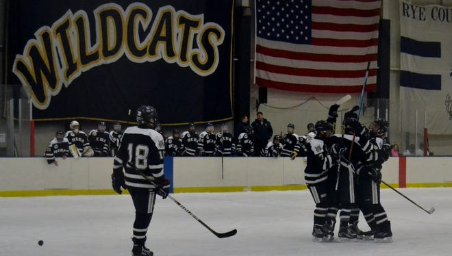 Rye Country Day celebrates a second period goal by Frank Tedeschi on Wednesday during a 5-1 win over Iona Prep.