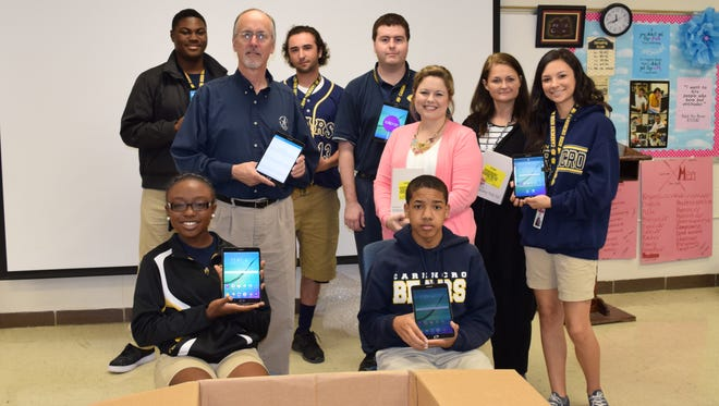 Carencro High students unpack new Samsung Galaxy tablets they received Monday.