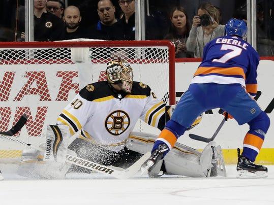 New York Islanders' Jordan Eberle (7) shoots the puck past Boston Bruins goaltender Tuukka Rask for a goal during the first period of an NHL hockey game Tuesday, Jan. 2, 2018, in New York. (AP Photo/Frank Franklin II)