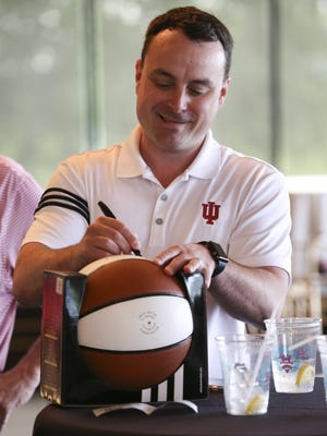 IU Head Basketball Coach Archie Miller signed a basketball before a fan event at Huber's Orchard, Winery and Vineyards in Borden, Indiana. May 30, 2018
