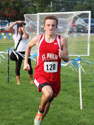 St. Philip senior Jack Greenman broke the Fighting Tigers school record in 2015, setting a new benchmark in 17:04.8.