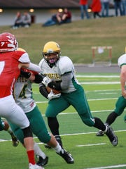 Pennfield sophomore Troy Hinds runs the ball during