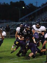Lakeview quarterback Skyler Nichols runs the ball during