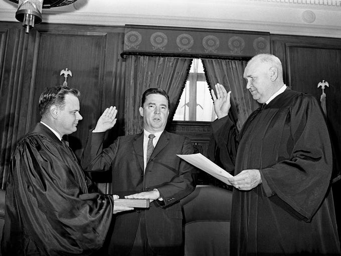 Charles Galbreath, center, is sworn in as judge of