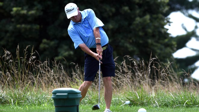 Jim Spargrove tees off the 15th hole in the final round of the Seniors Classic on Wednesday at Zanesville Country Club. Spargrove defeated Craig Baldwin by one shot to defend his title.