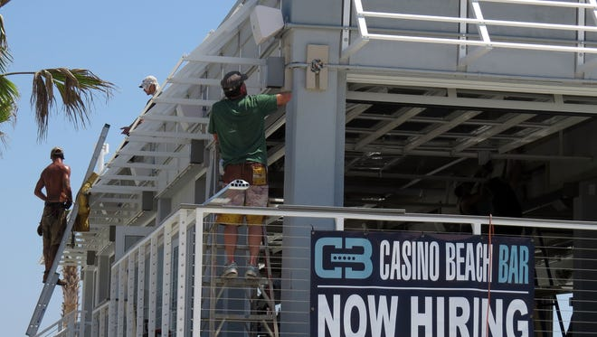 Seen here during construction, the Casino Beach Bar is now open at the base of the Pensacola Beach pier.