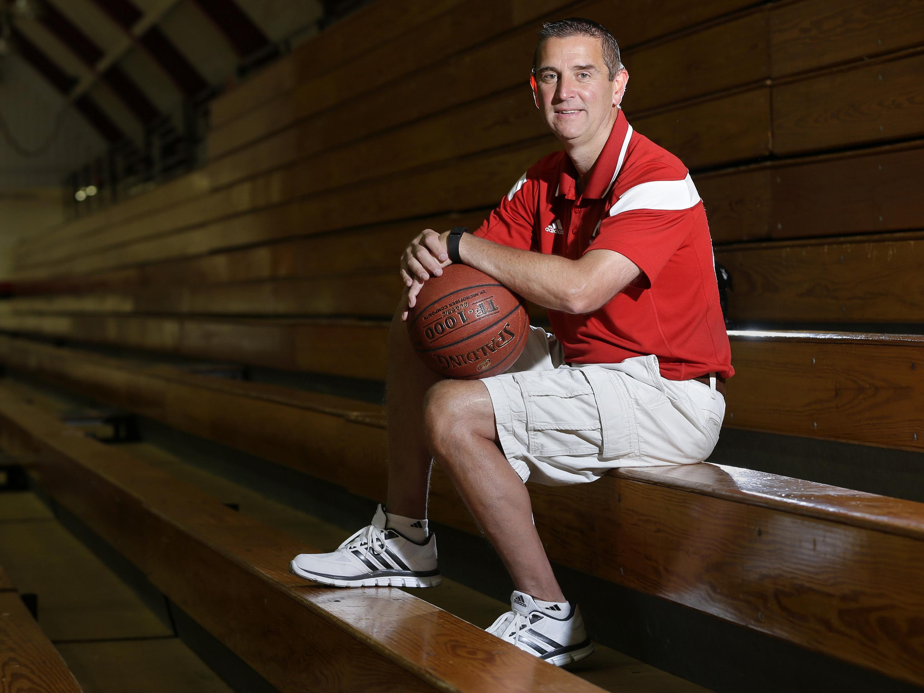 """Former Neenah boys' basketball head coach Scott Bork experienced a transient ischemic attack, or """"warning stroke,"""" during a game last season. Health concerns led to his resignation in May."""