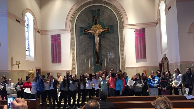 """Creating a community of faith is paramount at Mount Saint Mary Academy in Watchung, where seniors, some of whom are pictured, have the opportunity twice a year to embark on a four-day retreat at the Loyola Retreat House in Morristown to forge relationships and strengthen their spirituality. The name of the retreat, Kairos, translates from Greek as """"God's time,"""" and the seniors use this contemplative journey to reflect on the presence of God in everyday life, according to Isabel Gachko, the Academy campus minister and theology department chairwoman who guides the retreat. Gachko noted that the retreat themes are based on Saint Ignatius Loyola's """"Spiritual Exercises,"""" which features prayers, meditations on Scripture, and contemplative practices to help Christians see how God's grace is active in their daily lives. """"Kairos started out as a very small group and has grown into two retreats a year — one in November and one in February,"""" said Gachko, who attended for the eighth year this winter. """"Approximately, 70 to 80 percent of the senior class attends voluntarily. It is not a requirement to attend. Everyone has a story and hearing each other's stories helps them to grow as a community and brings them closer together."""" Mount Saint Mary Academy is a Catholic, independent school for young women in grades 9 through 12. Founded in 1908 as a sponsored work of the Sisters of Mercy, the Mount remains committed to challenging each student to develop her fullest potential in a Christian atmosphere of love and caring. For more info, visit http://www.mountsaintmary.org/."""