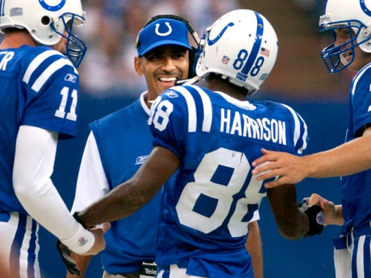 10-6-2002        Colts head coach Tony Dungy is all smiles after he congratulates wide receiver Marvin Harrison for connecting with Peyton Manning on a long bomb for 69 yards to the Bengals seven yard line on the last play of the third quarter of Sunday's game at the RCA Dome. The Colts won 28-21. (MATT DETRICH PHOTO) File 76082 w/story.
