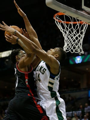 Bucks forward Giannis Antetokounmpo defends Raptors guard DeMar DeRozan during the first half of Toronto's Game 6 victory over Milwaukee on Thursday night at the BMO Harris Bradley Center.
