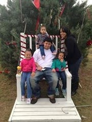 Joshua and Quintoria Simpson with their three daughters at a Christmas tree farm in Thomasville, Ga., in 2013.