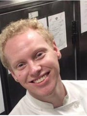 Joshua L'Heureux, 22, in his uniform at work. He died in 2016, riding his motorcycle. His parents have established a culinary arts scholarship in his honor.