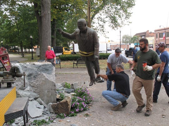 The statue of Orville Hubbard is removed from Dearborn City Hall in September 2015.