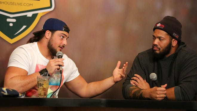 Green Bay Packers left tackle David Bakhtiari (left) talks with teammate and guard Josh Walker on the difficult task of coming into a game on a moment's notice during Monday's Clubhouse Live in Appleton.