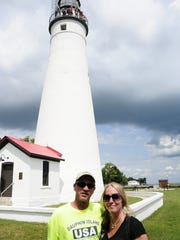 Siblings Bart Hutson-DeBolt and Denise Debolt stand outside the Fort Gratiot Lighthouse. The lighthouse is one of seven featured on cans of Vernors and Diet Vernors