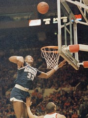 Georgetown's Patrick Ewing (33) is shown in action during game against St. John University at New York's Madison Square Garden, Feb. 27, 1985.  Georgetown won 85-69.