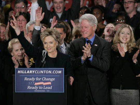 Then-Sen. Hillary Cinton waves to the crowd with husband Bill Clinton and daughter Chelsea at the Hotel Fort Des Moines Thursday Jan. 3, 2008.