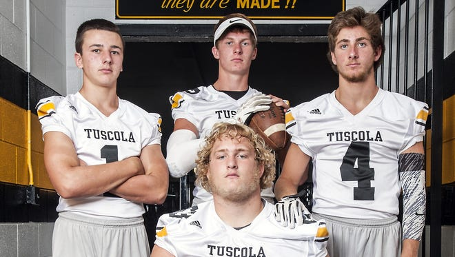 Tuscola football players Jordan Davis, Caleb Ferguson, Roman Jenkins and Zach Webster.