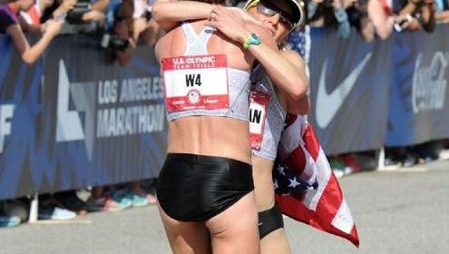 Amy Cragg holds up Shalane Flanagan at Saturday's U.S. Olympic Marathon Trials in Los Angeles.