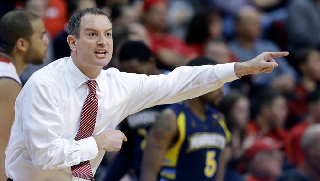 Rutgers coach Mike Rice shouts to his players during the second half of an NCAA college basketball game against on Marquette Tuesday, March 5, 2013, in Piscataway, N.J. Marquette won 60-54.
