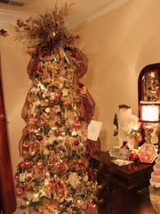A Victorian-themed Christmas tree sits in the master bedroom at Cindy Shirley's home.