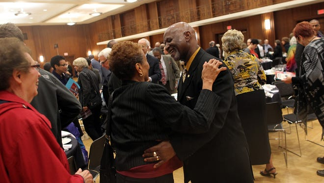 Orville Townsend greets friends following the Iowa City Human Rights Commission awards breakfast at the Iowa Memorial Union on Wednesday, Oct. 28, 2015. Townsend's keynote address reflected on his experiences with racism as a student.